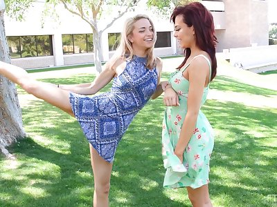 Cute teen lesbian couple Paisley and Sabina kissing outdoors